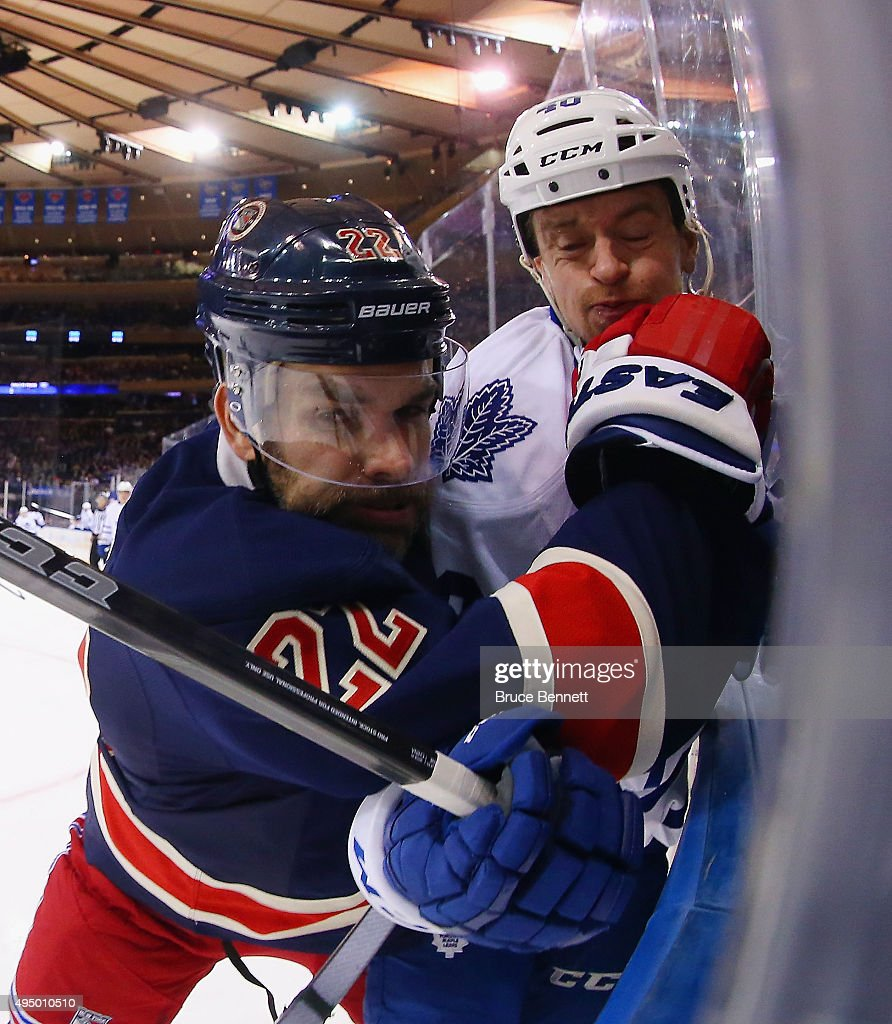 Dan Boyle #22 of the New York Rangers rides Michael Grabner #40 of the Toronto Maple Leafs into the boards during the first period at Madison Square Garden on October 30, 2015 in New York City.