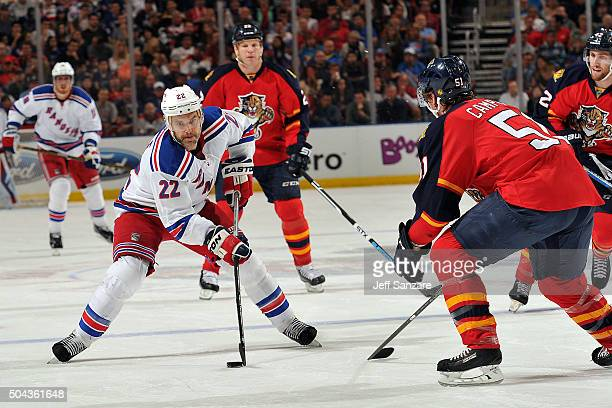 Dan Boyle of the New York Rangers skates with the puck against Brian Campbell of the Florida Panthers at the BBT Center on January 2 2016 in Sunrise...
