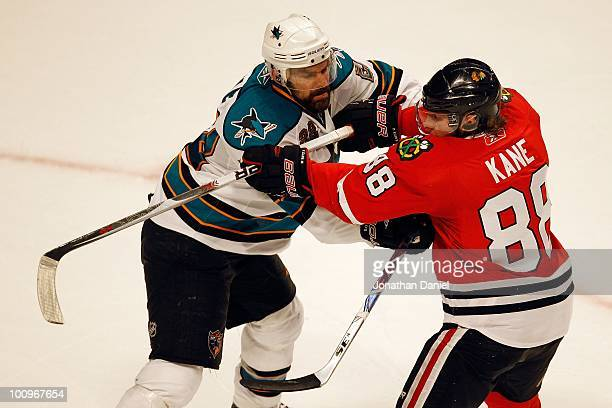 Dan Boyle of the San Jose Sharks checks Patrick Kane of the Chicago Blackhawks in Game Four of the Western Conference Finals during the 2010 NHL...