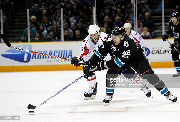 Dan Boyle of the San Jose Sharks fights for the puck with Mike Knuble of the Washington Capitals in the third period during an NHL hockey game at the...