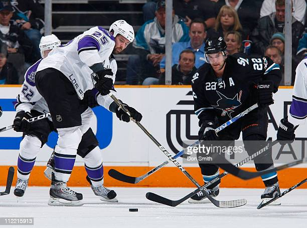 Dan Boyle of the San Jose Sharks pursues the puck against Trevor Lewis and Dustin Penner of the Los Angeles Kings in Game 1 of the Western Conference...