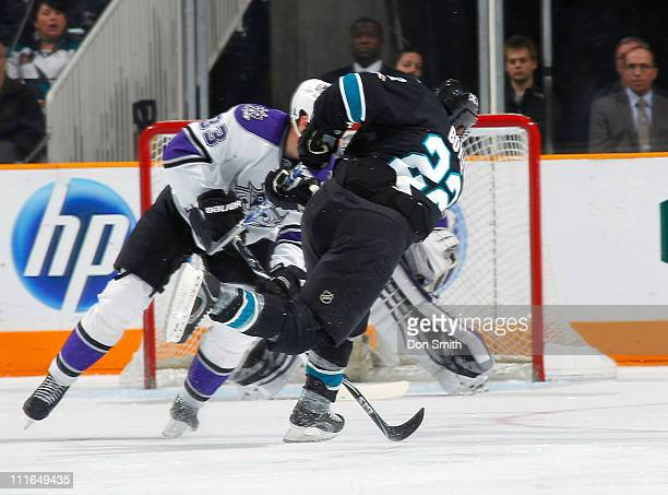 Dan Boyle of the San Jose Sharks scores a goal against Willie Mitchell of the Los Angeles Kings during an NHL game on April 4 2011 at HP Pavilion at...