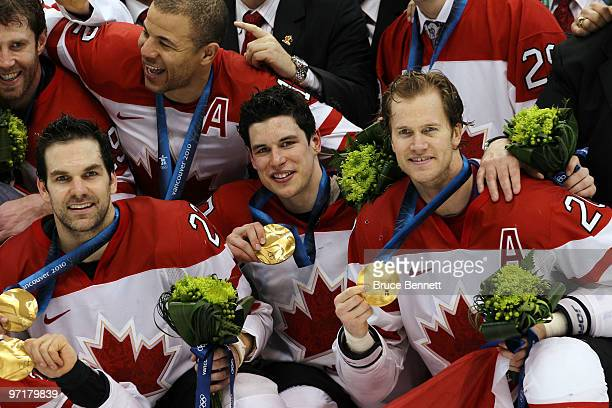 Dan Boyle Sidney Crosby and Chris Pronger of Canada celebrate with the gold medals won during the ice hockey men's gold medal game between USA and...