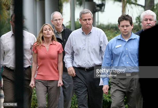 Dan Brown, general manager of SeaWorld Adventure Park, center, walks with Kelly Flaherty Clark, left, curator of animal training at SeaWorld, prior...