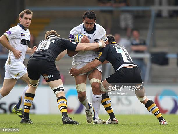 Dan Browne of Leeds is tackled by James Cannon and Dan WardSmith during the Aviva Premiership match between London Wasps and Leeds Carnegie at Adams...
