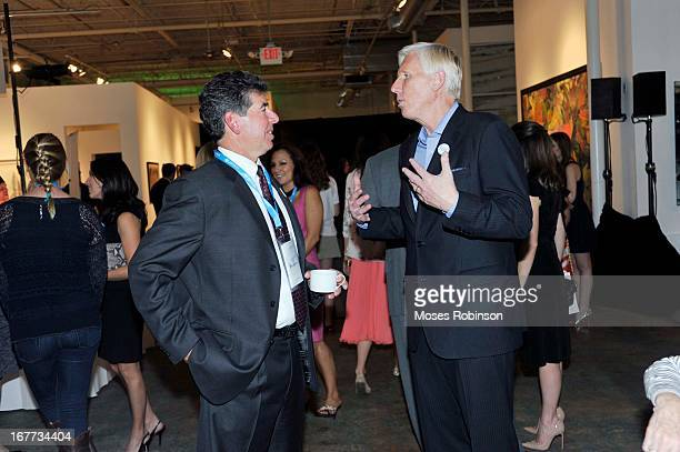 Dan Brutto and Robert Thompson attend The UNICEF Experience at Mason Murer Fine Art Gallery on April 28 2013 in Atlanta Georgia