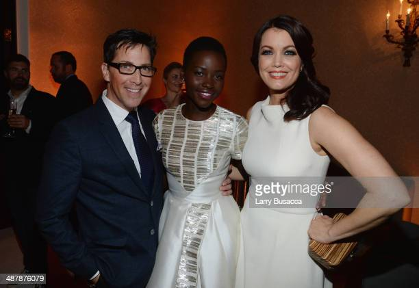 Dan Bucatinsky, Lupita Nyong'o and Bellamy Young attend the PEOPLE/TIME WHCD cocktail party at St Regis Hotel - Astor Terrace on May 2, 2014 in...