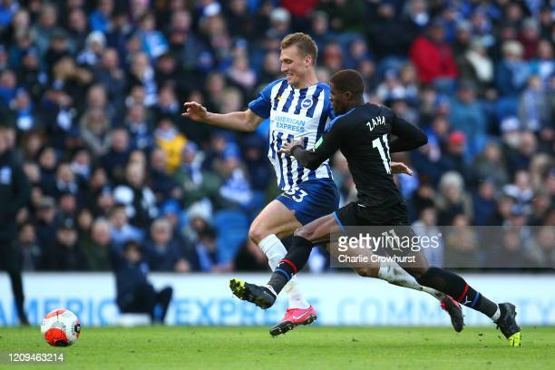 Dan Burn of Brighton and Hove Albion and Wilfried Zaha of Crystal Palace during the Premier League match between Brighton Hove Albion and Crystal...
