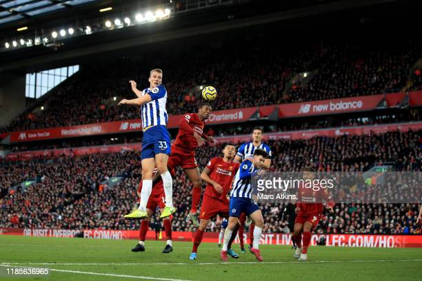 Dan Burn of Brighton and Hove Albion in action with Georginio Wijnaldum of Liverpool during the Premier League match between Liverpool FC and...