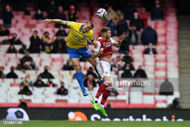 Dan Burn of Brighton & Hove Albion battling for the header with Calum Chambers of Arsenal during the Premier League match between Arsenal and...