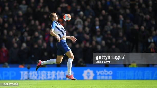 Dan Burn of Brighton Hove Albion chests the ball during the Premier League match between Brighton Hove Albion and Crystal Palace at American Express...