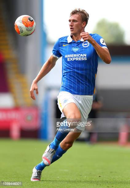 Dan Burn of Brighton Hove Albion runs with the ball during the Premier League match between Burnley FC and Brighton Hove Albion at Turf Moor on July...