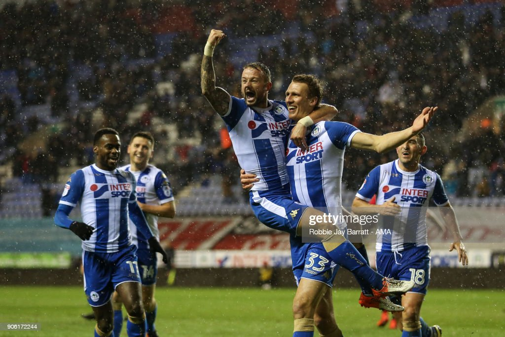 Dan Burn of Wigan Athletic celebrates after scoring a goal to make it 2-0 during The Emirates FA Cup Third Round Replay between Wigan Athletic v AFC Bournemouth at DW Stadium on January 17, 2018 in Wigan, England.