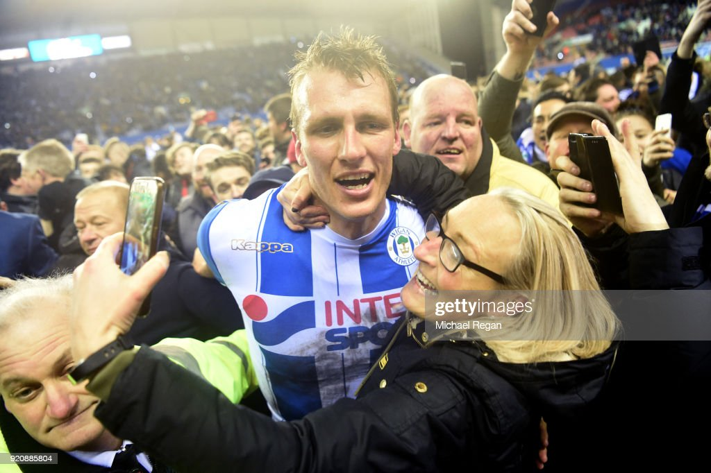 Dan Burn of Wigan Athletic celebrates after the Emirates FA Cup Fifth Round match between Wigan Athletic and Manchester City at DW Stadium on February 19, 2018 in Wigan, England.