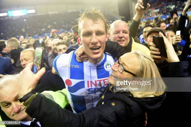 Dan Burn of Wigan Athletic celebrates after the Emirates FA Cup Fifth Round match between Wigan Athletic and Manchester City at DW Stadium on...