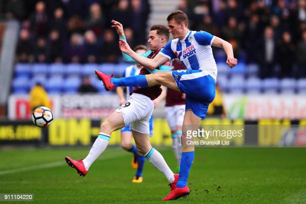 Dan Burn of Wigan Athletic in action with Antonio Martinez of West Ham United during the Emirates FA Cup Fourth Round match between Wigan Athletic...
