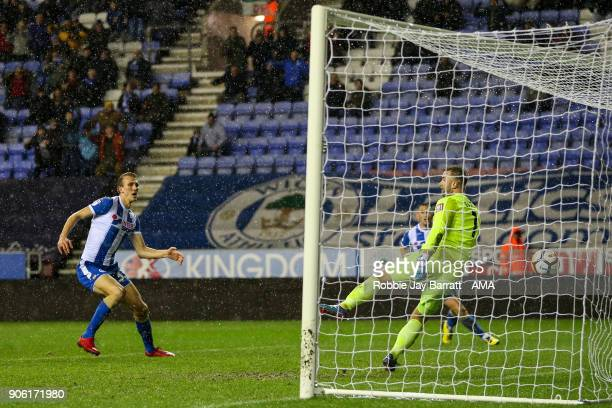 Dan Burn of Wigan Athletic scores a goal to make it 20 during The Emirates FA Cup Third Round Replay between Wigan Athletic v AFC Bournemouth at DW...