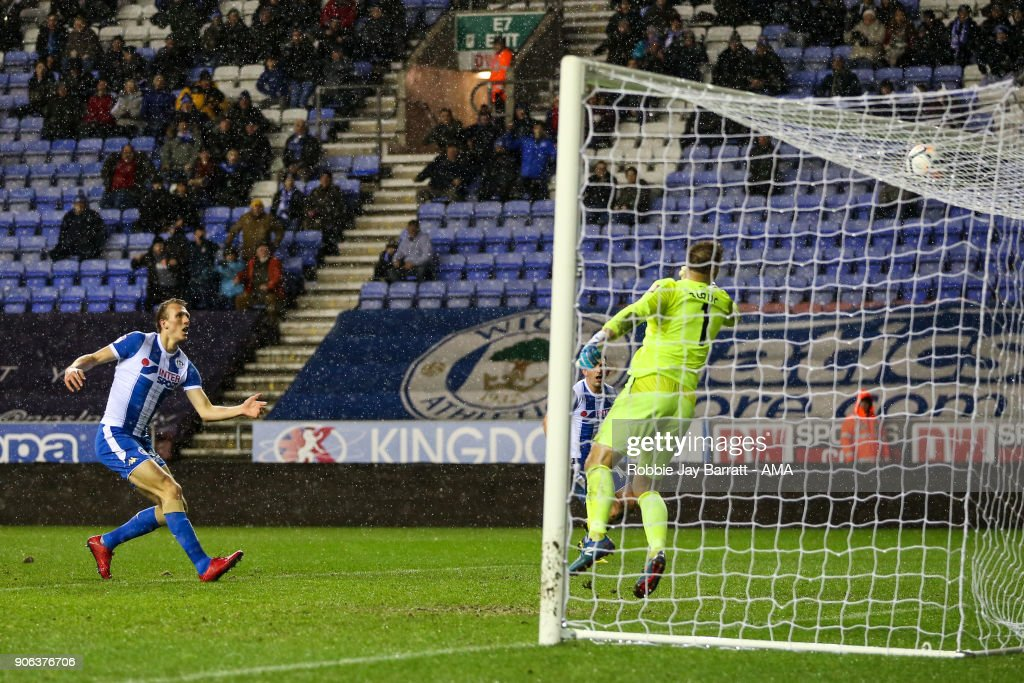 Dan Burn of Wigan Athletic scores a goal to make it 2-0 during The Emirates FA Cup Third Round Replay between Wigan Athletic v AFC Bournemouth at DW Stadium on January 17, 2018 in Wigan, England.