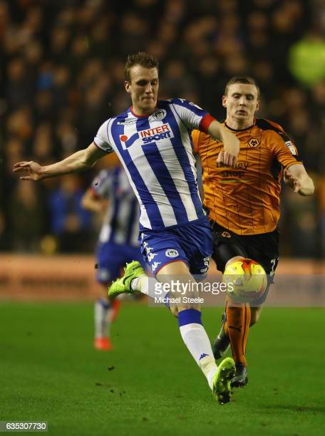 Dan Burn of Wigan clears from Jon Dadi Bodvarsson of Wolverhampton during the Sky Bet Championship match between Wolverhampton Wanderers and Wigan...