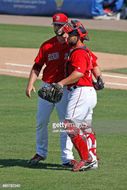Dan Butler congratulates Ben Taylor of the Boston Red Sox after the final out against the Washington Nationals in the ninth inning during a spring...