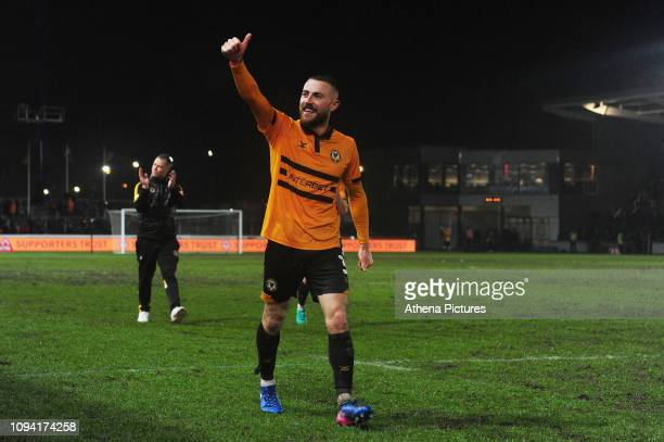 Dan Butler of Newport County gives a thumbs up to the crowd at full time during the FA Cup Fourth Round Replay match between Newport County and...