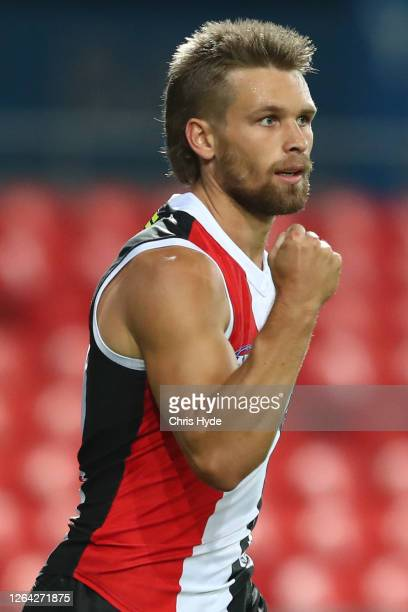 Dan Butler of the Saints celebrates a goal during the round 10 AFL match between the Gold Coast Suns and the St Kilda Saints at Metricon Stadium on...
