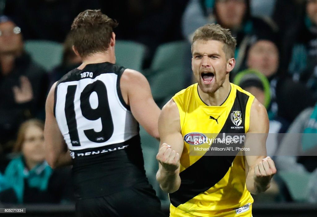 Dan Butler of the Tigers celebrates a goal during the 2017 AFL round 15 match between the Port Adelaide Power and the Richmond Tigers at Adelaide Oval on July 01, 2017 in Adelaide, Australia.
