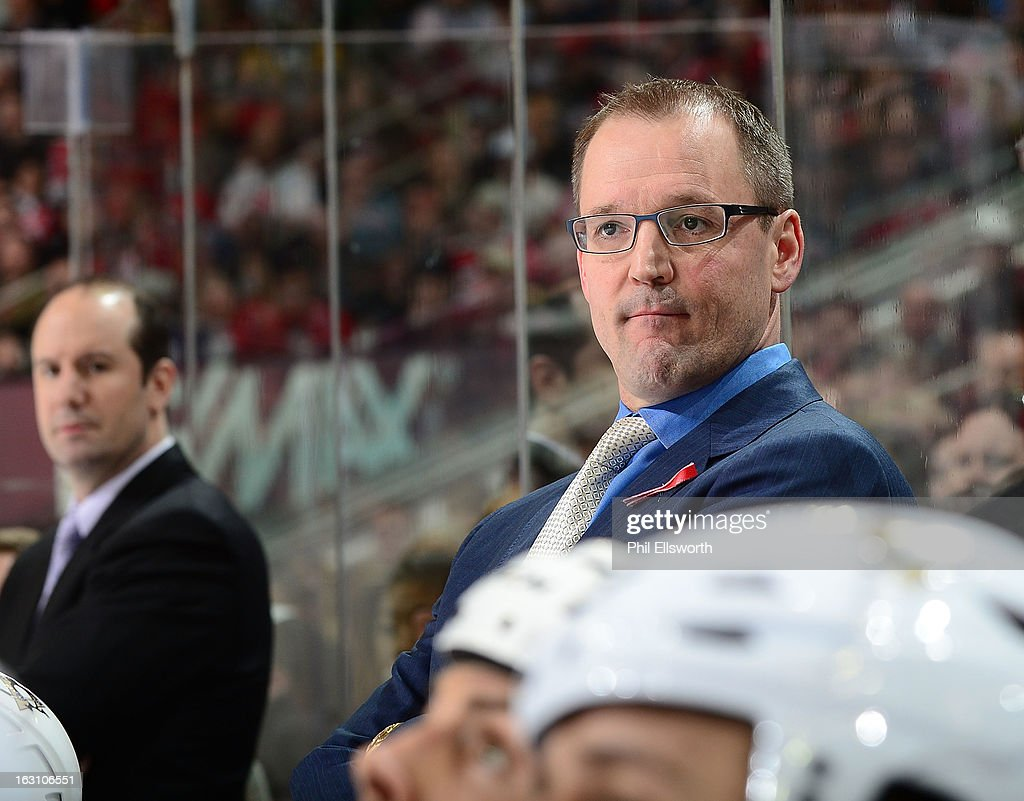Dan Bylsma of the Pittsburgh Penguins looks out onto the ice during an NHL game against the Carolina Hurricanes on February 28, 2013 at PNC Arena in Raleigh, North Carolina.