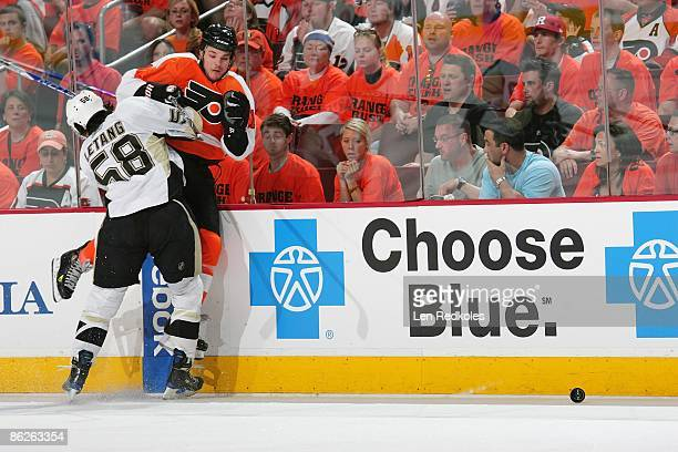 Dan Carcillo of the Philadelphia Flyers is checked off the puck along the boards by Kris Letang of the Pittsburgh Penguins during Game Six of the...