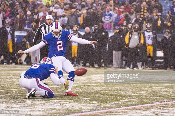 Dan Carpenter of the Buffalo Bills kicks a point after try during the fourth quarter against the Pittsburgh Steelers on December 11 2016 at New Era...