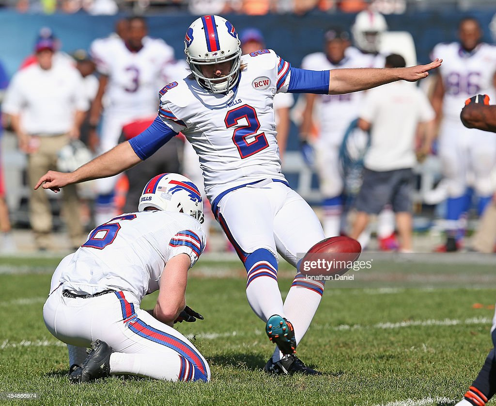 Dan Carpenter #2 of the Buffalo Bills kicks the game winning field goal in overtime to defeat the Chicago Bears 23-20 at Soldier Field on September 7, 2014 in Chicago, Illinois.