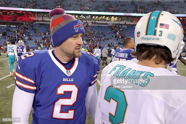 Dan Carpenter of the Buffalo Bills talks to Andrew Franks of the Miami Dolphins after the game at New Era Stadium on December 24 2016 in Orchard Park...