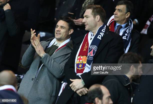 Dan Carter and Ali Williams attend the UEFA Champions League Round of 16 first leg match between Paris SaintGermain and FC Barcelona at Parc des...