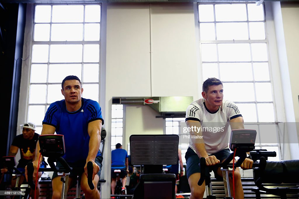 Dan Carter (L) and Colin Slade (R) of the All Blacks warm up during a New Zealand All Blacks Gym session at the Cardiff University Strength and Conditioning Centre on November 17, 2014 in Cardiff, Wales.
