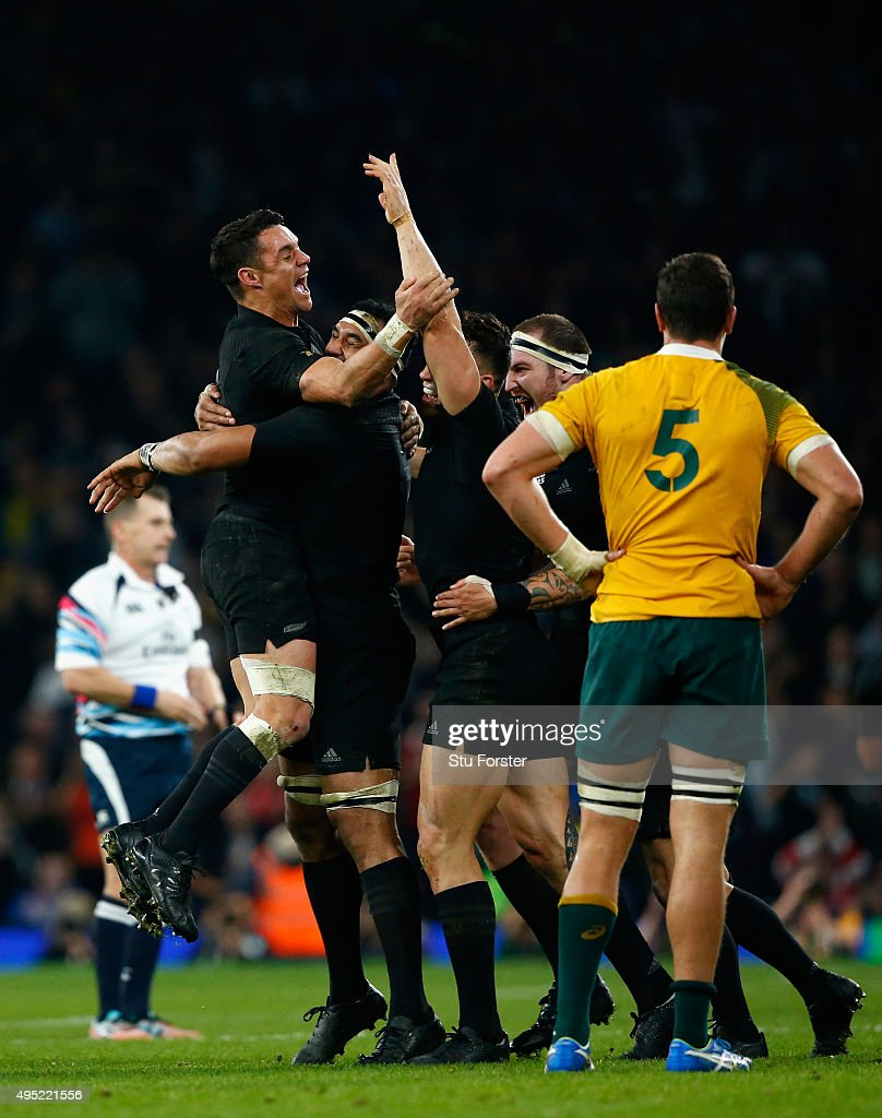 Dan Carter (l) and New Zealand team mates celebrate on the final whistle after the 2015 Rugby World Cup Final match between New Zealand and Australia at Twickenham Stadium on October 31, 2015 in London, United Kingdom.