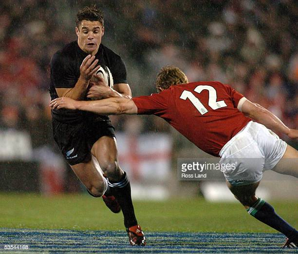 Dan Carter breaks through the tackle of Jonny Wilkinson , during the All Blacks V British and Irish Lions rugby test at Jade Stadium, Christchurch,...