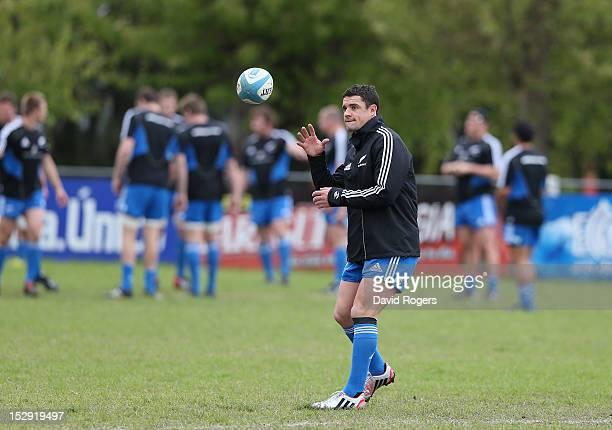 Dan Carter catches the ball during the New Zealand All Blacks captain's run at Centro Naval on September 28 2012 in Buenos Aires Argentina