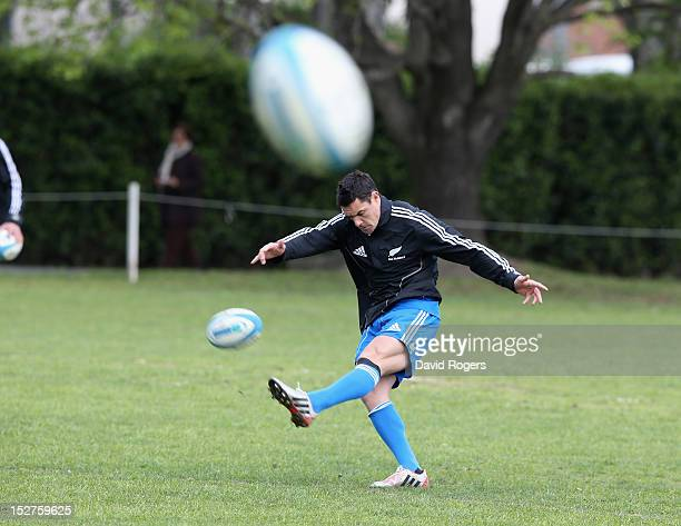 Dan Carter kicks the ball upfield during a New Zealand All Blacks training session held at St George's College on September 25 2012 in Buenos Aires...