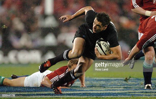 Dan Carter leaves Jonny Wilkinson sprawling, during the All Blacks 213 win over the British and Irish Lions rugby test at Jade Stadium, Christchurch,...