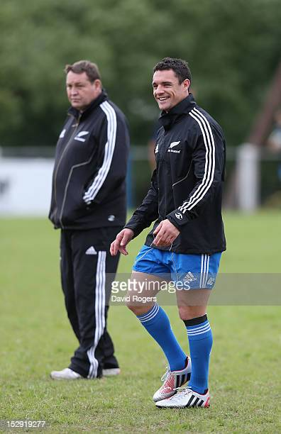 Dan Carter looks on with Steve Hansen the head coach during the New Zealand All Blacks captain's run at Centro Naval on September 28 2012 in Buenos...