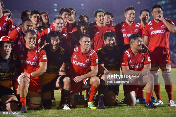 Dan Carter of Kobelco Steelers and players poses for photographs after the Rugby Top League match between Suntory Sungoliath and Kobelco Steelers at...