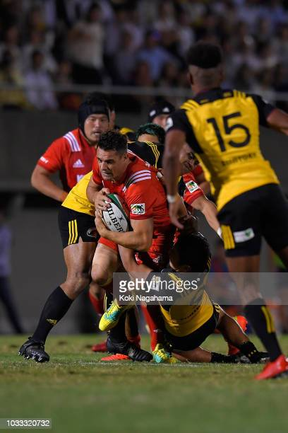 Dan Carter of Kobelco Steelers is tackled during the Rugby Top League match between Suntory Sungoliath and Kobelco Steelers at Prince Chichibu...