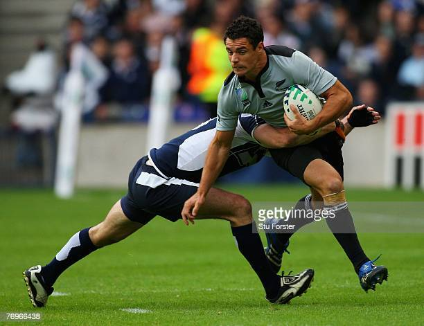 Dan Carter of New Zealand attempts to break free of the Scotland defence during the Rugby World Cup 2007 Pool C match between Scotland and New...