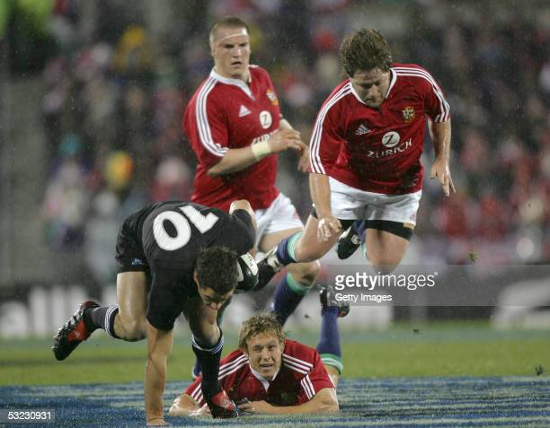 Dan Carter of New Zealand bursts through the Lions defence during the 1st Test match between the New Zealand All Blacks and the British and Irish...