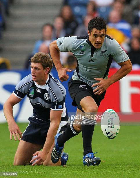Dan Carter of New Zealand chases the ball during the Rugby World Cup 2007 Pool C match between Scotland and New Zealand at the Murrayfield Stadium on...