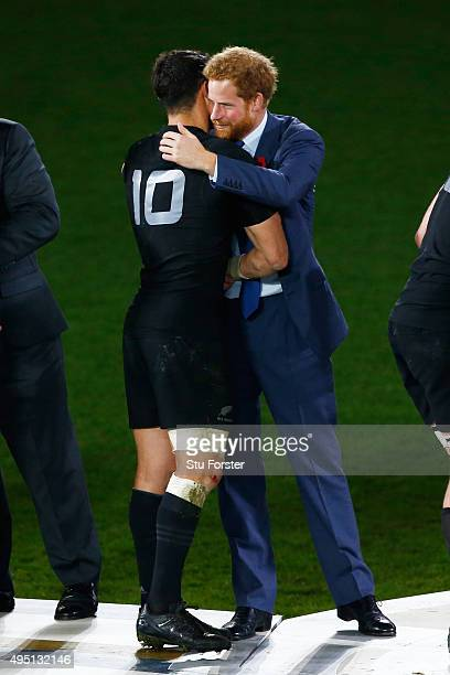 Dan Carter of New Zealand is congratulated by Prince Harry after victory in the 2015 Rugby World Cup Final match between New Zealand and Australia at...