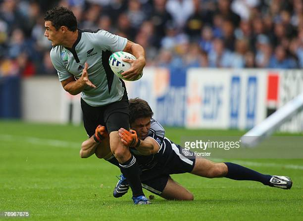 Dan Carter of New Zealand is tackled by Marcus Di Rollo of Scotland during the Rugby World Cup 2007 Pool C match between Scotland and New Zealand at...