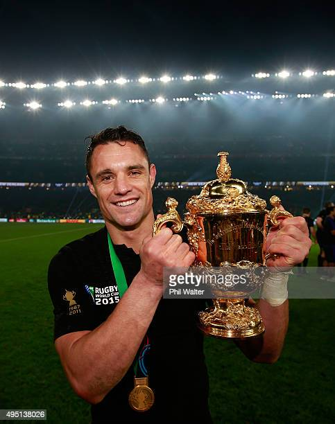 Dan Carter of New Zealand poses with the Webb Ellis Cup after victory in the 2015 Rugby World Cup Final match between New Zealand and Australia at...