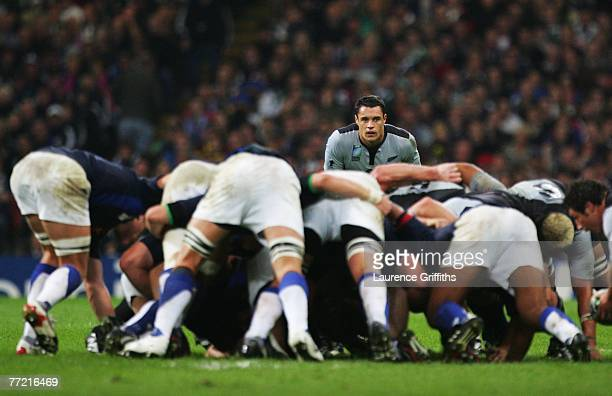 Dan Carter of New Zealand watches the scrum during the Quarter Final of the Rugby World Cup 2007 match between New Zealand and France at the...