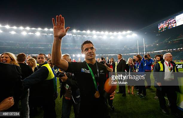 Dan Carter of New Zealand waves to the crowd after victory in the 2015 Rugby World Cup Final match between New Zealand and Australia at Twickenham...